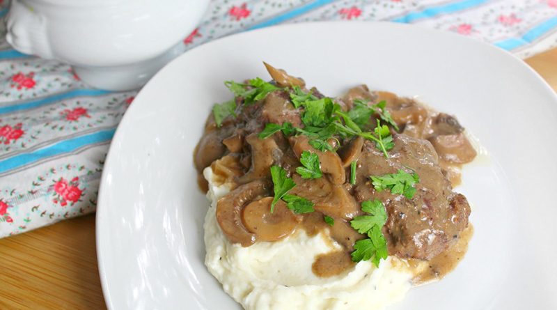 featured image showing the finished Salisbury steak recipe over mashed potatoes.