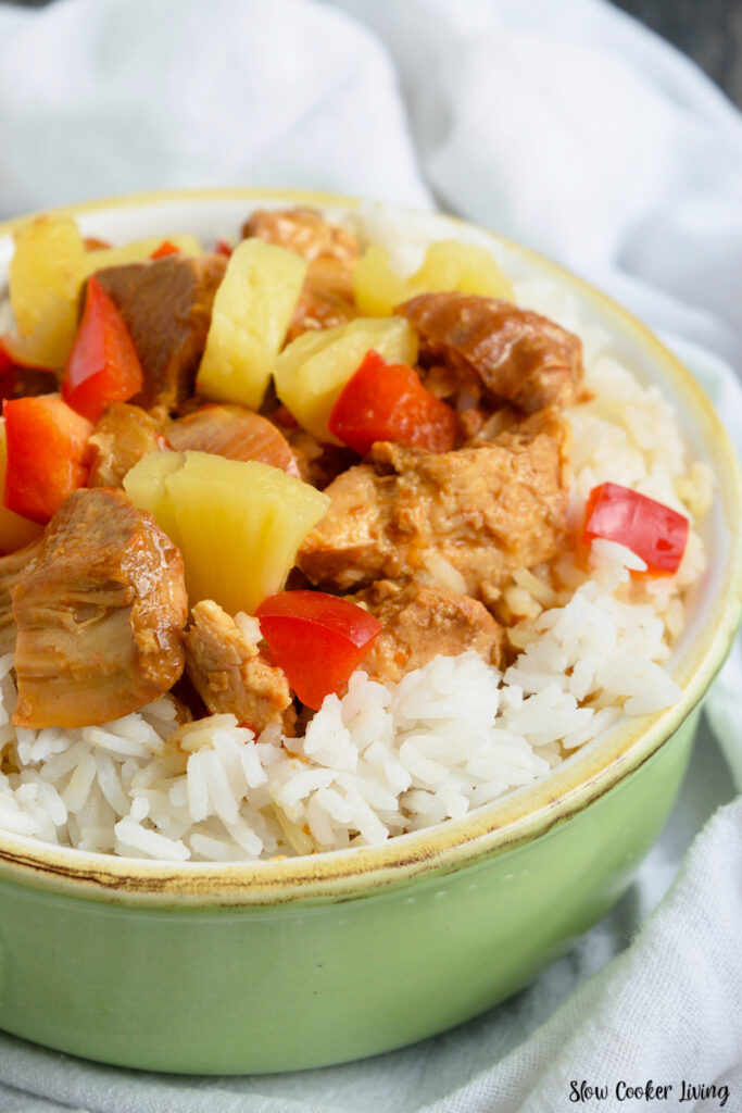 Finished slow cooker pineapple chicken over rice ready to eat.
