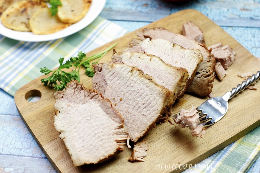 A view of the fully sliced pork roast that has been cooked in the crockpot.