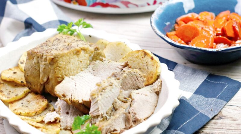 This featured image shows the finished crock pot pork roast sliced and ready to be eaten.