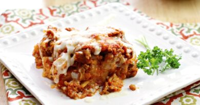 A featured image that shows a slice of the delicious slow cooker lasagna finished and ready to eat.