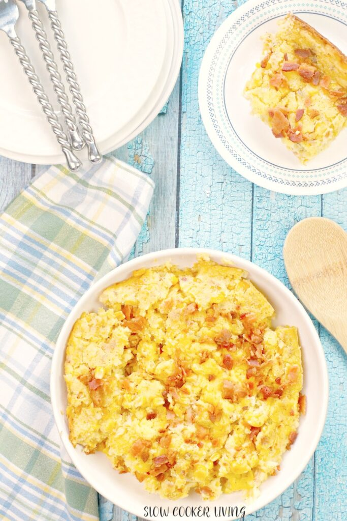 A top down look at a bowl full of finished corn and bacon casserole.