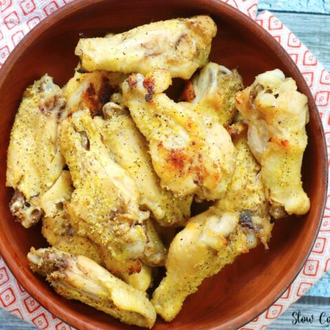 Featured image showing a bowl full of crockpot lemon pepper wings ready to eat.