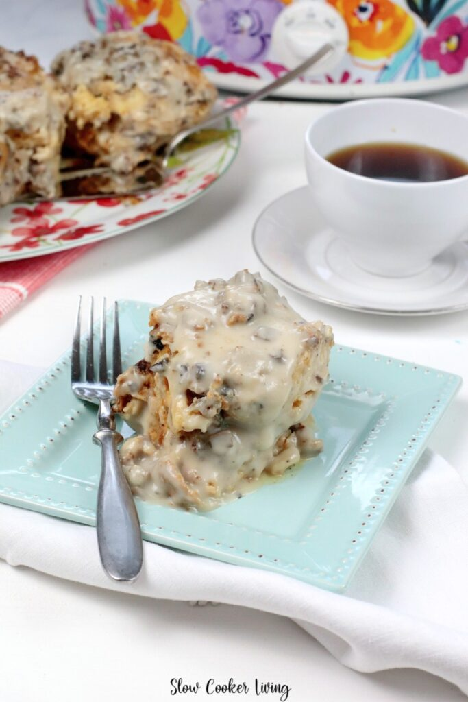 A serving of this delicious breakfast casserole on a plate ready to eat.
