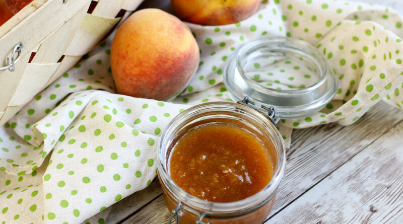 A view of the finished peach butter recipe in a jar ready to be sealed and shared.
