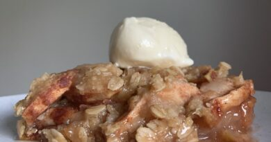 A serving of the finished apple crisp ready to eat.