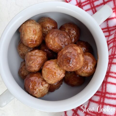 Featured image showing the finished crockpot grape jelly meatballs ready to serve.