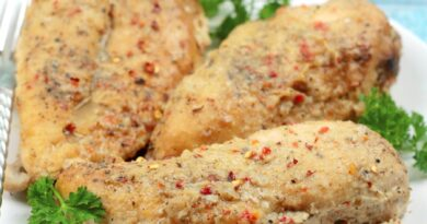 Featured image showing the finished crockpot lemon pepper chicken ready to eat.