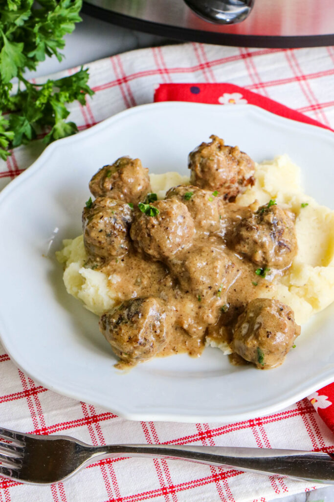 Finished Swedish meatballs over mashed potatoes ready to eat.