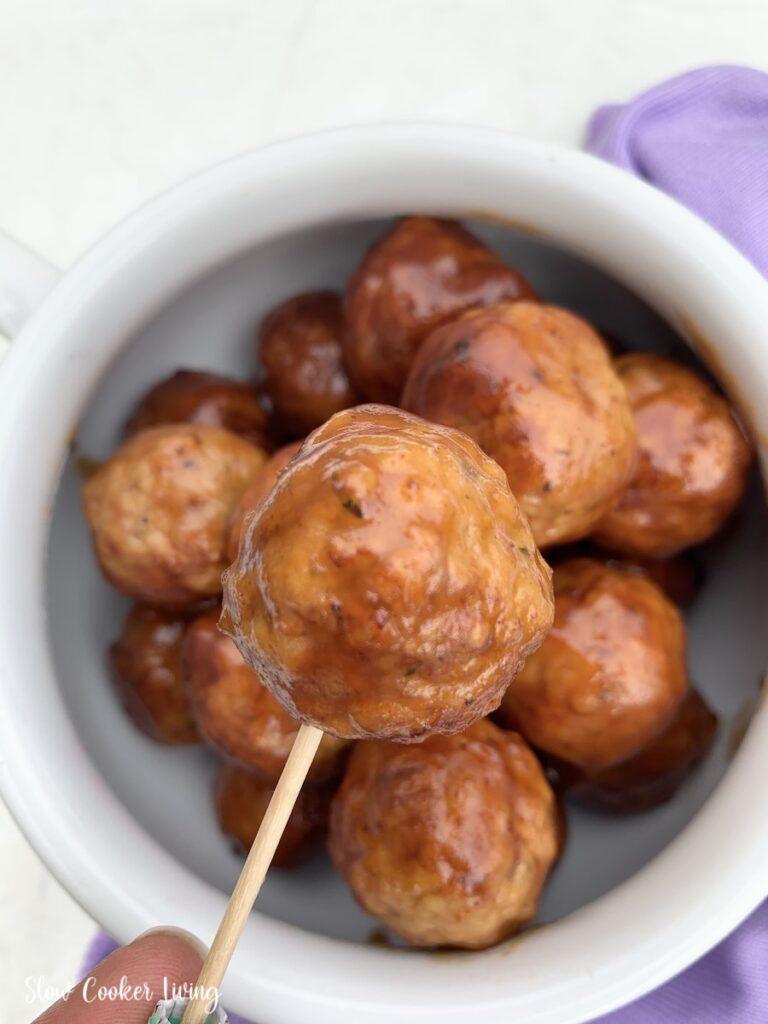 Crockpot cranberry meatballs on a stick ready to serve.
