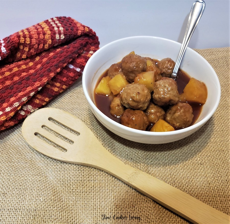 A bowl of the finished meatballs with a serving spoon ready to dish out!