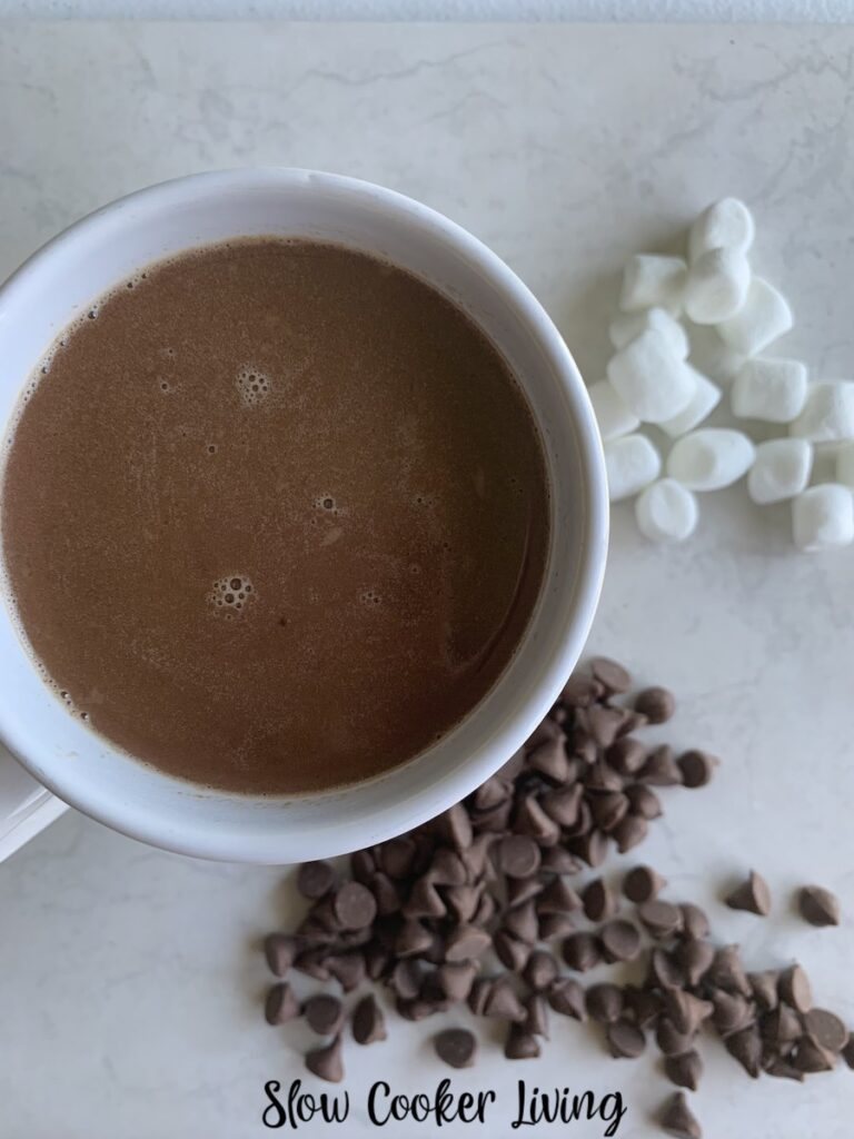 A top down look at a mug full of the slow cooker hot cocoa ready to drink.