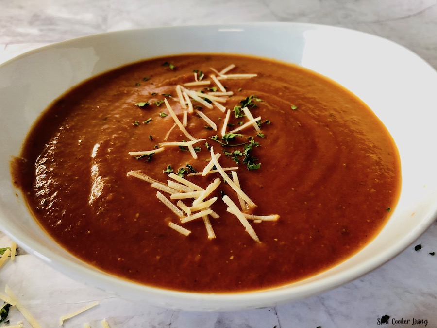 A bowl full of the finished crockpot tomato soup ready to serve.