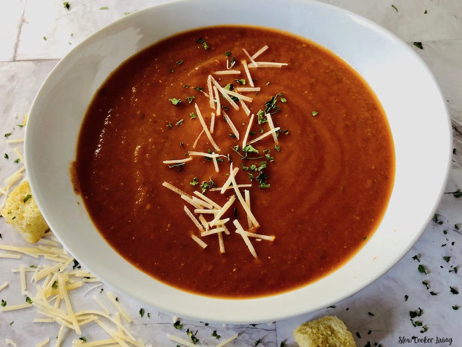 A bowl full of crockpot tomato soup ready to eat.