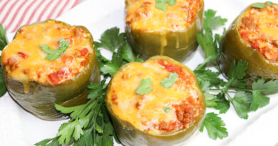 Featured image showing the finished crock pot stuffed peppers ready to eat.