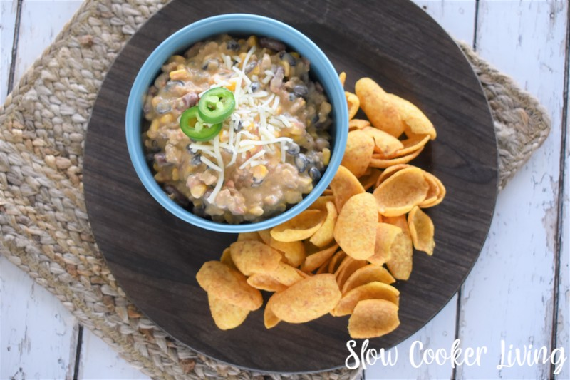 Featured image showing the finished crockpot cheese dip ready to eat with chips.