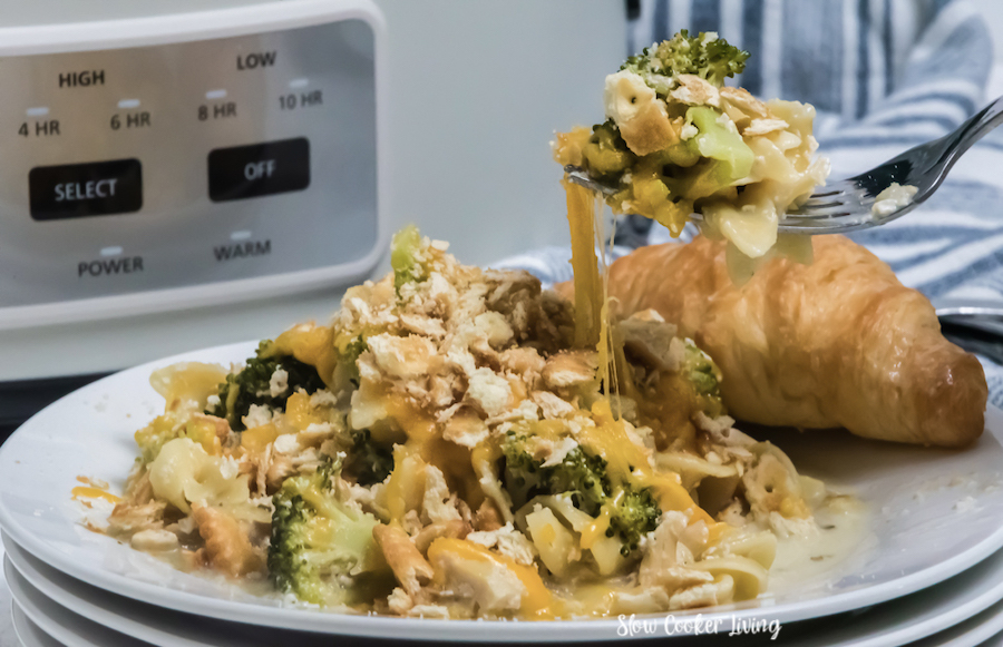 Featured image showing the finished slow cooker chicken and broccoli on a fork ready to eat.