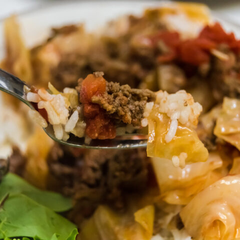 Featured image showing the finished unstuffed cabbage rolls on a fork ready to be eaten.
