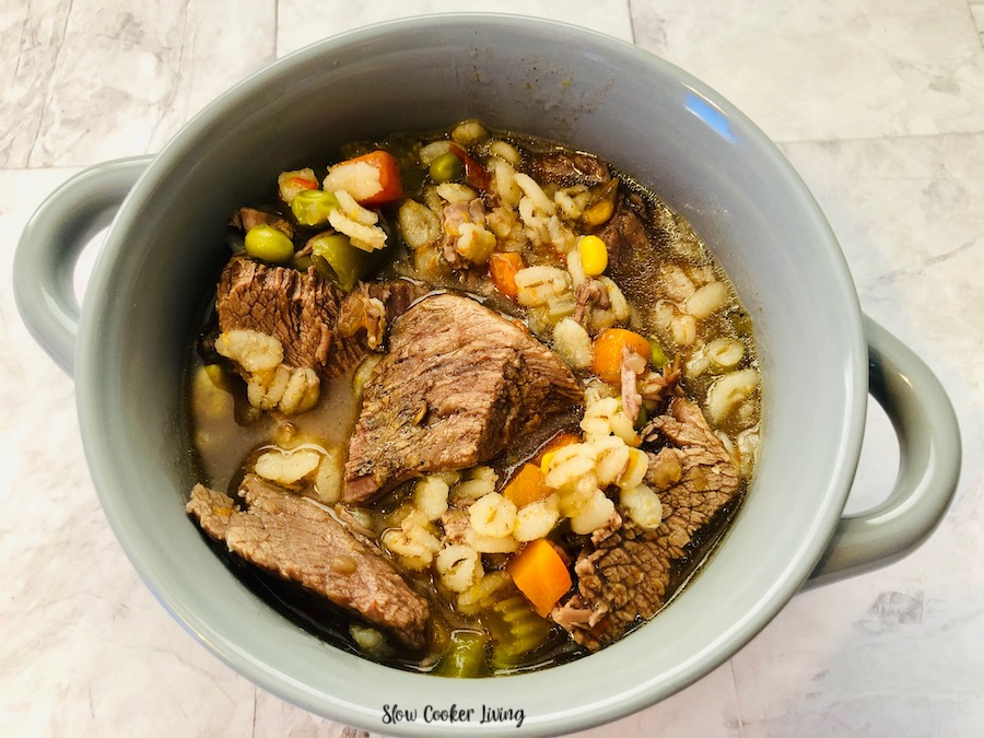 A top down look at the bowl full of beef barley soup made in the slow cooker ready to eat.