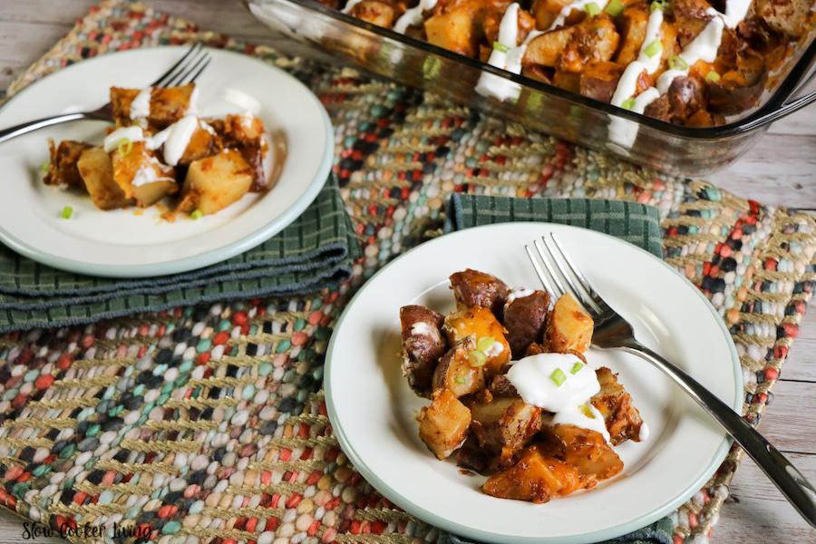 Finished crockpot loaded potatoes ready to eat on a plate.