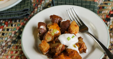 Featured image showing a serving of finished crockpot loaded potatoes ready to eat.