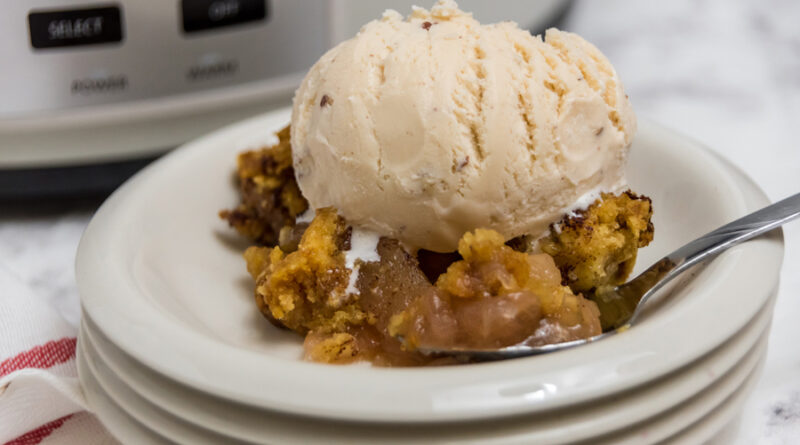 Featured image showing the finished apple cobbler made in the Crock pot ready to eat.