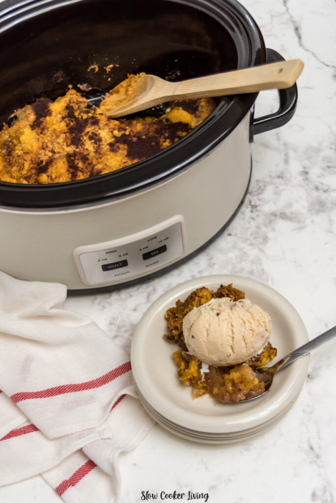 A view into the crock pot of finished apple cobbler ready to eat.