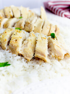 Featured image showing the finished sprite chicken ready to eat with rice under.