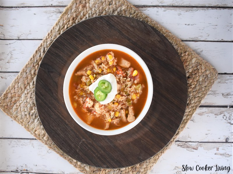 A bowl of chicken taco soup ready to eat.