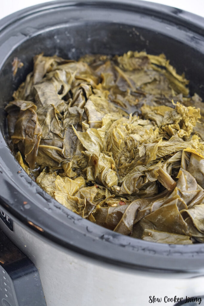 A look at the crockpot full of cooked collard greens.