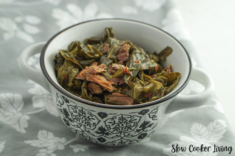 Featured image showing the finished crockpot collard greens ready to eat in a bowl.